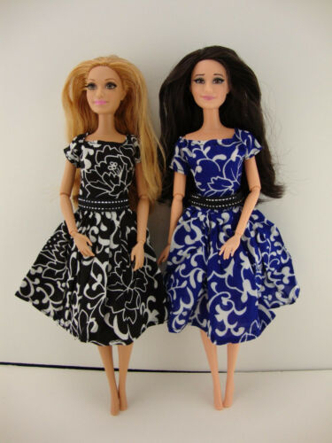 A Set of 2 Dresses in Black and Blue with a White Floral Pattern