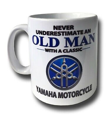 NORTON  NEVER UNDERESTIMATE AN OLD MAN WITH A.. 11 OZ GLAZED WHITE CERAMIC MUG.