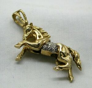 Beautiful-Heavy-9-carat-Gold-And-White-Stone-Articulated-Horse-Pendant