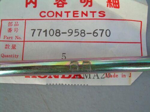 77108-958-670 NOS Honda seat lock lever fits 1981-83 ATC185
