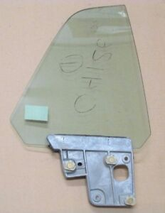 1969 MERCURY COUGAR XR7 RIGHT/PASSENGER SIDE QUARTER GLASS GREEN NOS W/ BRACKET