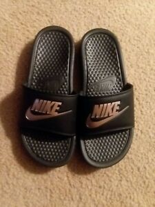 nike slippers with gold logo