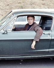 Bullitt Steve McQueen at wheel of classic Ford Mustang 390 GT car on set Photo