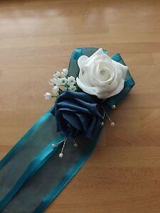 Wedding-flowers-bridesmaids-wrist-corsage-Teal-white-roses-diamante-pearls
