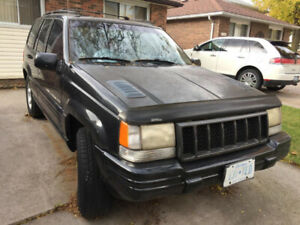 1998 Grand Cherokee. AS IS. Drivable.