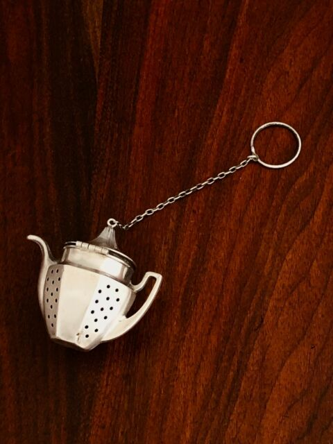 - AMERICAN STERLING SILVER TEA INFUSER IN THE SHAPE OF A TEAPOT NO MONOGRAM