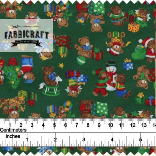 Christmas Fabric  Small Teddies Snowmen /& Toys on green 100/% cotton 1 metre