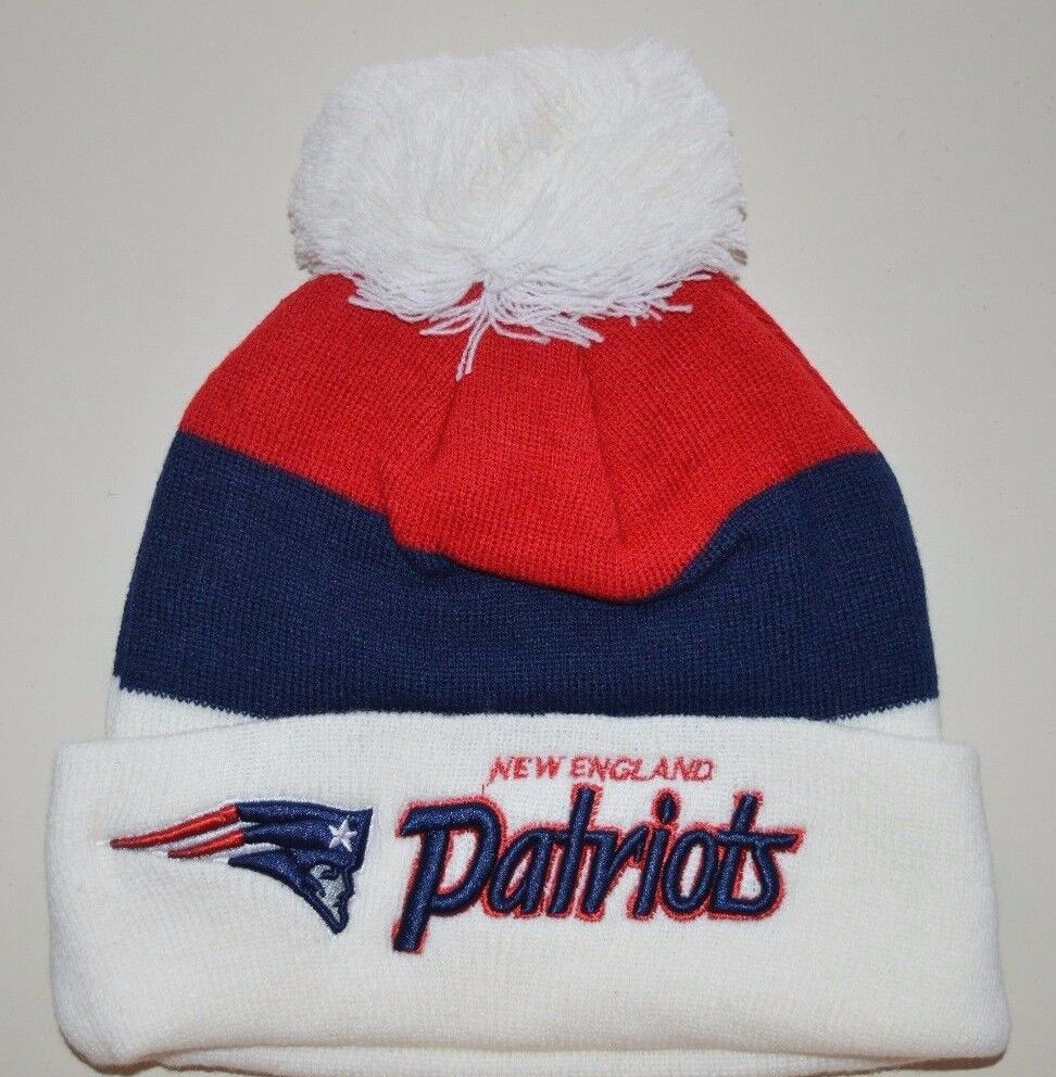 White-blue-red Patriots beanie hat with Patriots and New England script and pom pom