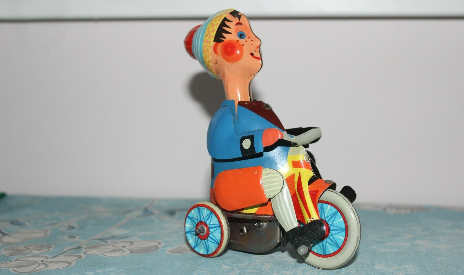 Collector model boy on a tricycle with simulated leg action, tin toy USSR