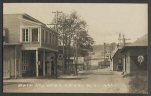 Howes-Cave-NY-c-1915-20-RPPC-Postcard-MAIN-STREET-Store-Texaco-Railroad-Sta