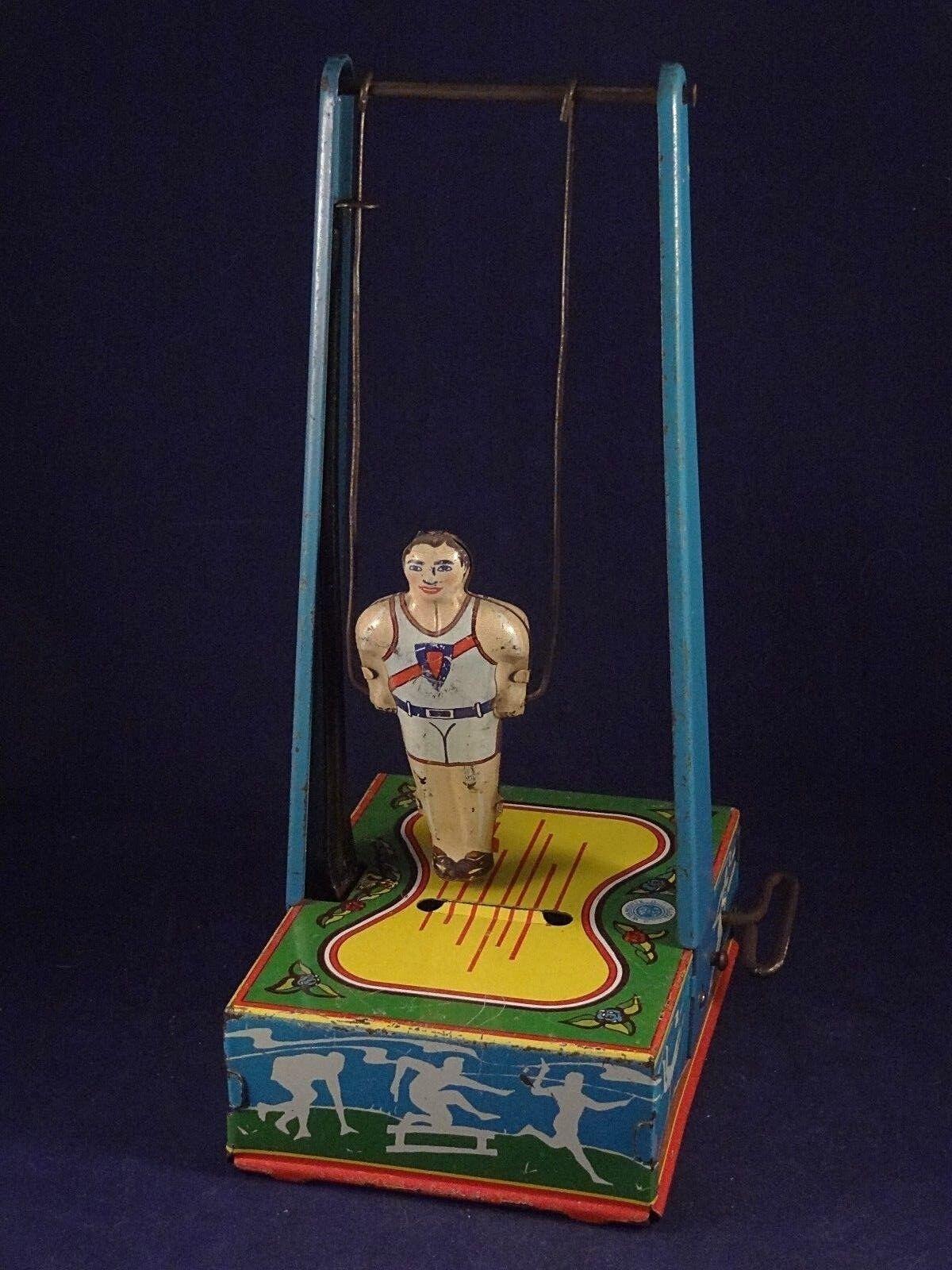 Ancien jouet tôle mécanique sport gymnastique anneaux WYANDOTTE TOYS USA J.O.