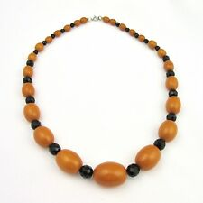 Collier ancien en bakelite couleur jaune d'oeuf et perles de verre noires
