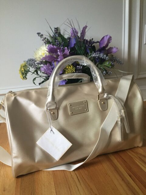 c9f220f828e6 NWT MICHAEL KORS Metallic gold duffle Faux leather travel gym overnight  shoulder