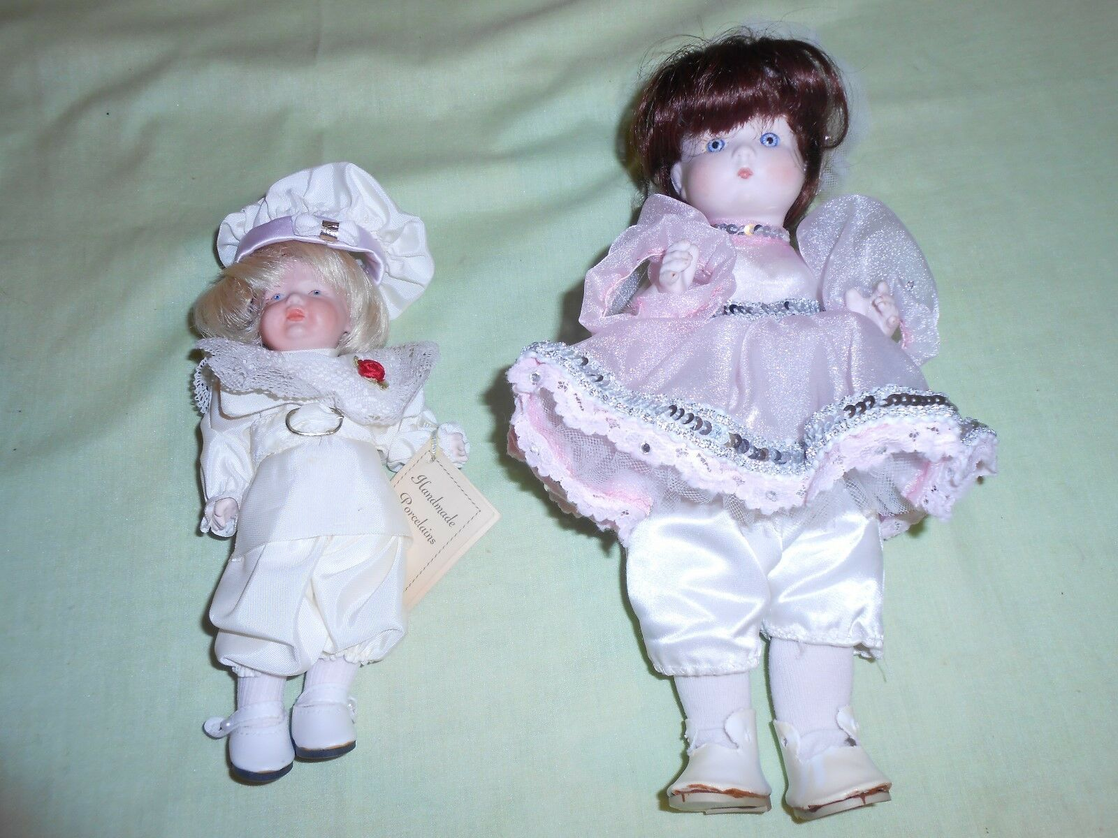 2 Handmade Porcelain Dolls, signed J. Lewis.  From Hummel Gift Shop