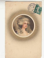 CK86.Vintage Postcard.  Head of a pretty lady in an embossed circle of gold.