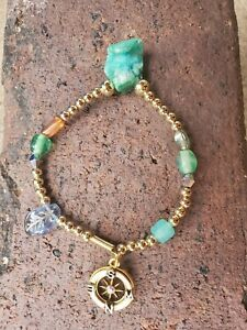 Womens-handmade-gold-stretch-bracelet-with-sea-green-stone-amp-gold-compass