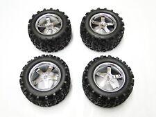 "Traxxas Revo 3.3 Four 4 Hurricane Chrome Wheels with 6.3/"" Maxx Tires 4973R"