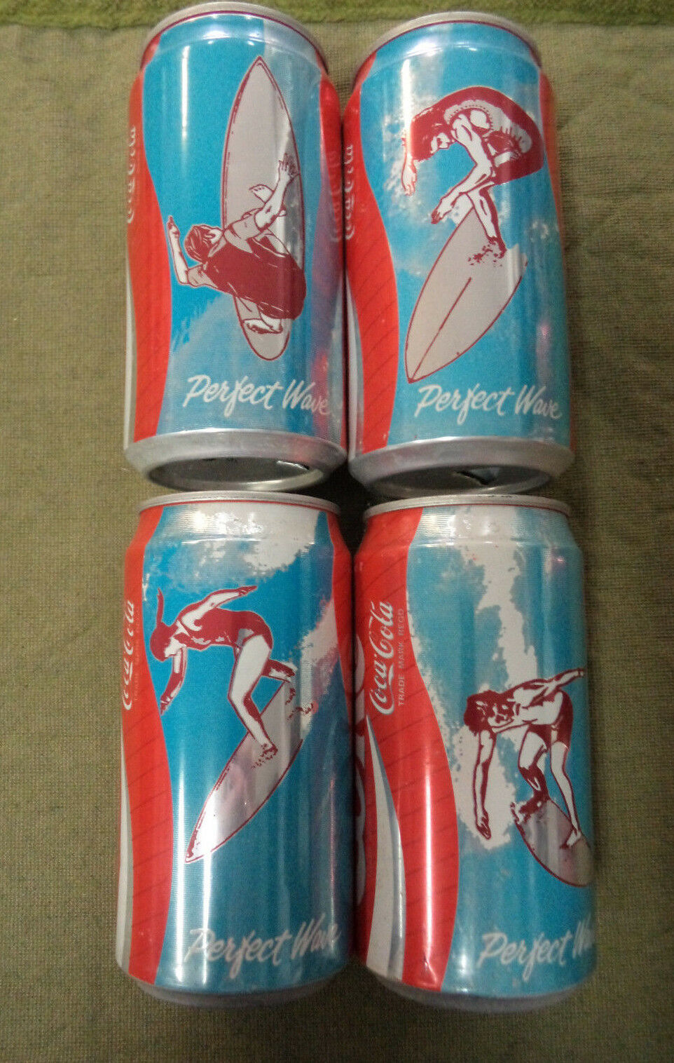 YY9.  SURFING COCA COLA COKE CAN SET - VICTORIA  ISSUE