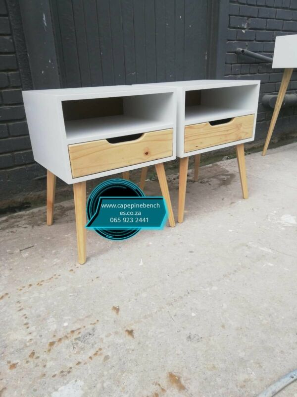 NEATLY MADE BED SIDE STOOLS AND PEDESTALS