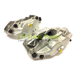 LAND-ROVER-DEFENDER-NEW-FRONT-BRAKE-CALIPERS-X2-SOLID-DISCS-SEB500440-450-300TDi