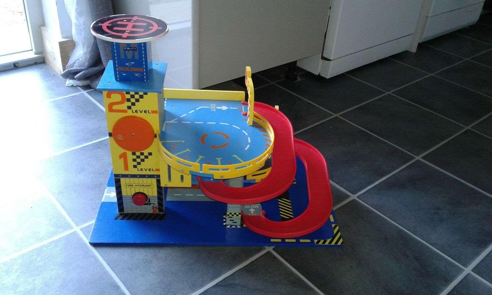Parking toy,dimentions 60cm x 40cm x 48 cm,used,very good condition, by unknown