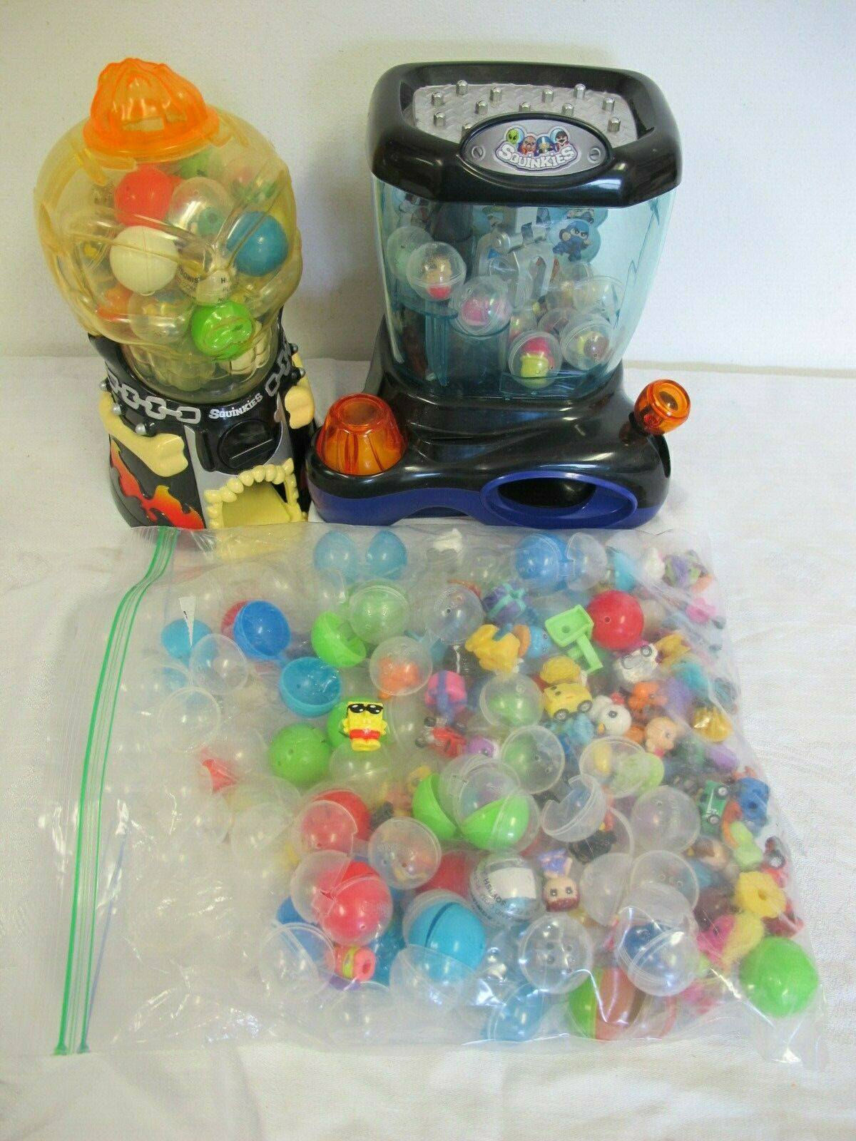 SQUINKIES  CRAZY CRANE CLAW -SKULL CAVERN BUBBLES FIGURES LOT