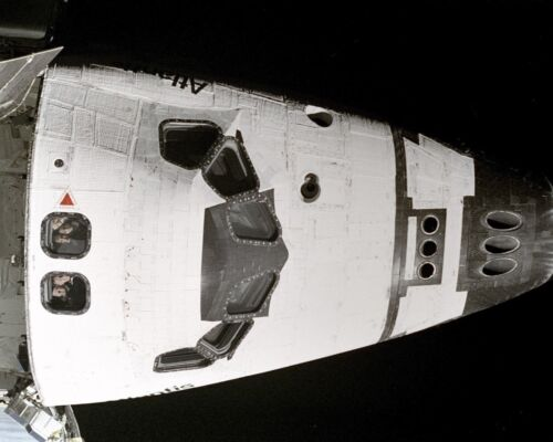 Crew of Space Shuttle Atlantis looks out windows at Station Mir Photo Print