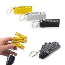 Un Mini Porte-clés Mètre 50 cm - Mesurer Règle Rétractable Ruban Mesureur