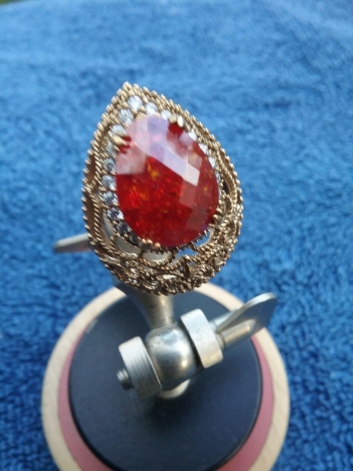 gold tone& white sapphire ring