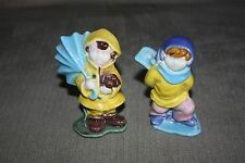 Boy And Girl Figurines With Rain Jackets And Umbrella