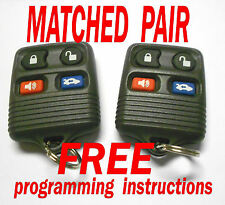 OEM MATCHED PAIR FORD LINCOLN MERCURY 4 BUTTON KEYLESS REMOTE ENTRY FOB GREY