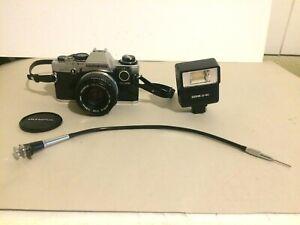 Ensemble appareil photo OLYMPUS OM 10 + FLASH SP 140 + accessoire