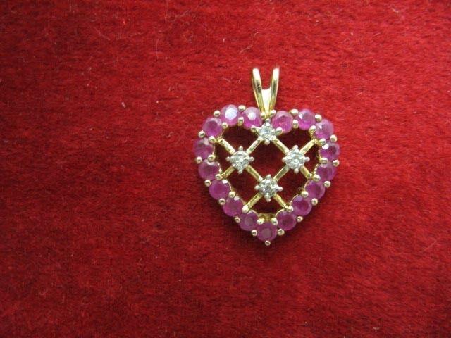 10K gold Ruby Heart Pendant - 16 Rubies & 4 Small Diamonds