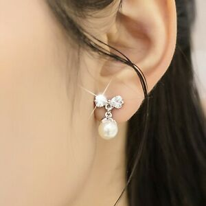 18K-WHITE-GOLD-GF-MADE-WITH-SWAROVSKI-CRYSTAL-PEARL-BOW-TIE-STUD-EARRINGS