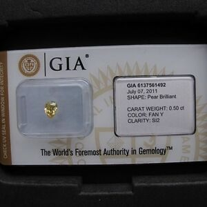 GIA-Cert-0-50ct-Pear-cut-diamond-NATURAL-FANCY-YELLOW-SI-2-SEALED-A-Beauty