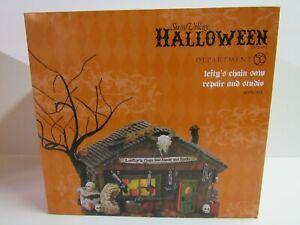 Dept-56-Snow-Village-Halloween-Lefty-039-s-Chain-Saw-Repair-And-Studio-4056703-MIP