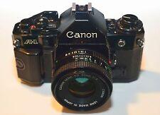 CANON – BOITIER A-1 NOIR + FD CANON LENS 50MM F/2 – BON ÉTAT