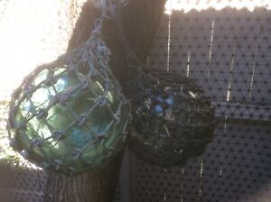 Pair of vintage glass rope fishing floats original condition