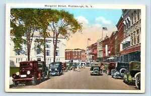 Plattsburgh-NY-1920s-MARGARET-STREET-SCENE-OLD-CARS-5-amp-DIME-POSTCARD