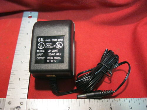 New AC DC Power Supply Adapter Cord Input:120V AC 60Hz to Output:9 V DC 600mA