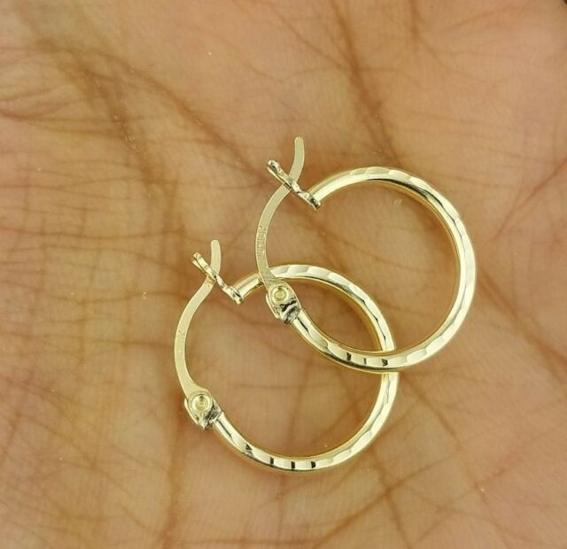 1.2IN Long 14k White Gold Polished and Textured Oval Hoop Earrings