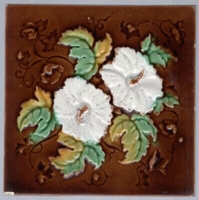 Antique 1900s English Corn Bros Art Nouveau amber and red flower tile