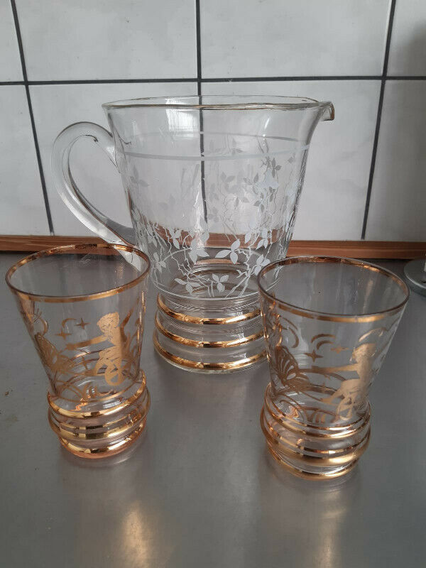glass pitcher and 2 glasses