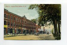Littleton NH Main Street view looking West, old cars, stores, people, 1910