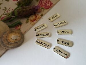 Details about TIBETAN WORD TAG CHARMS, LOVE, FAMILY, BLESSED, FOREVER,  BEAUTIFUL, DREAM, HOPE
