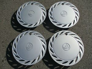 Genuine-1992-to-1998-Mercury-Tracer-14-inch-hubcaps-wheel-covers-nice