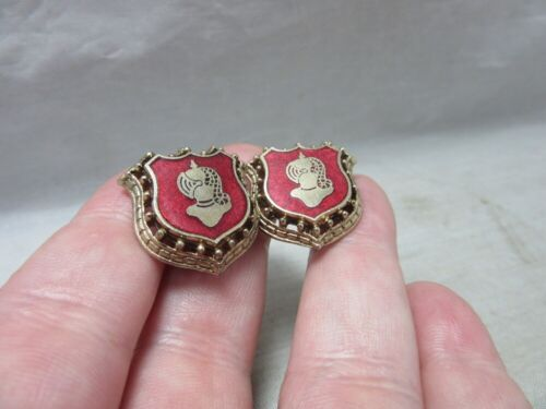 Vintage screw back enamel earrings. Knight, shield