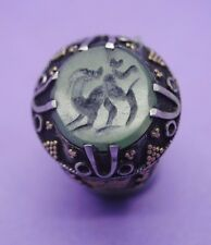Post Medieval Islamic silver ring inlaid with gold and animal seal insert