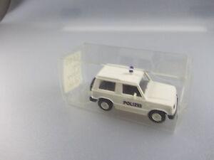 Rietze: Police-voiture Nº 50180 Mitsubishi Mmc Pajero (gk7)-afficher Le Titre D'origine