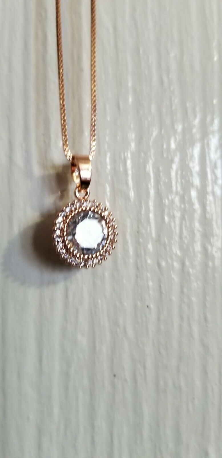 14k Rose gold plated Cz stone circle stone full work pendent necklace.